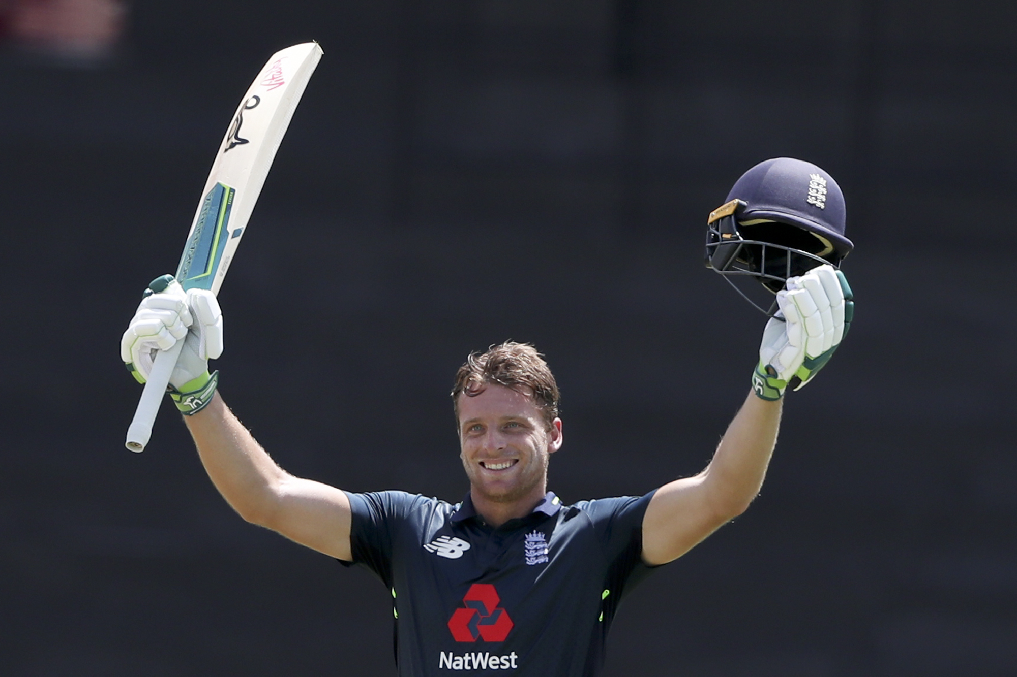 England's Jos Buttler celebrates after he scored a century against West Indies during the fourth One Day International cricket match at the National Stadium in St. George's, Grenada, Wednesday, Feb. 27, 2019. (AP Photo/Ricardo Mazalan).
