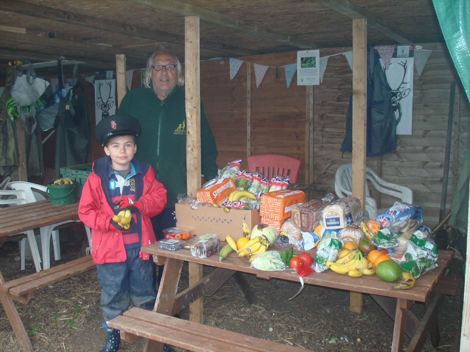 GRATEFUL: Mike Gage and a young volunteer pictured with their latest Lidl haul