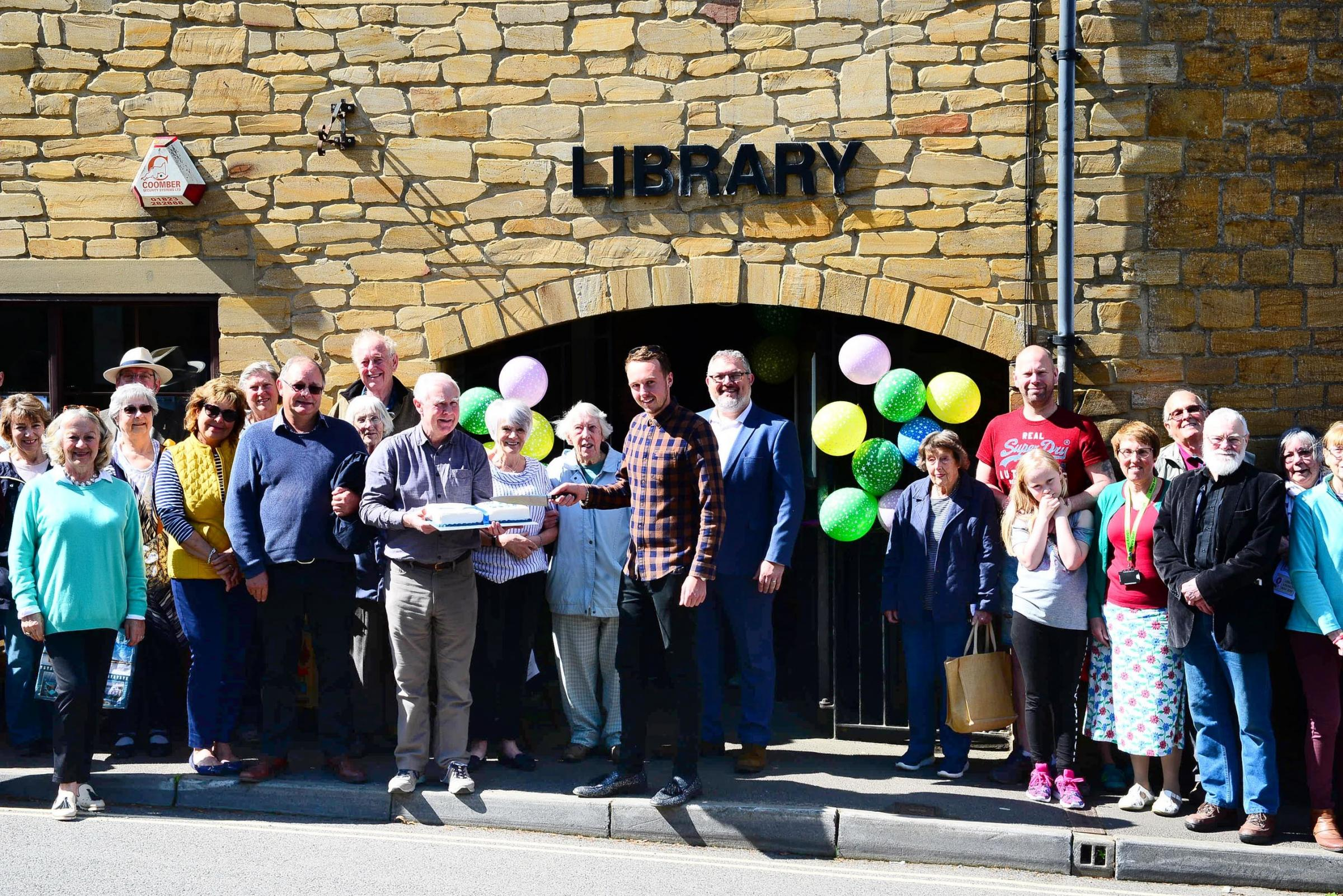 RELAUNCH: Supporters of South Petherton Library celebrate the facility's relaunch