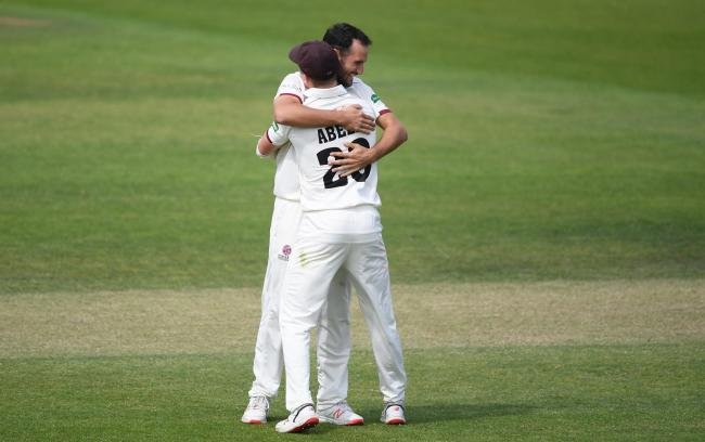 DELIGHT: Lewis Gregory celebrates taking the first wicket of the day with his skipper Tom Abell. Pic: SCCC