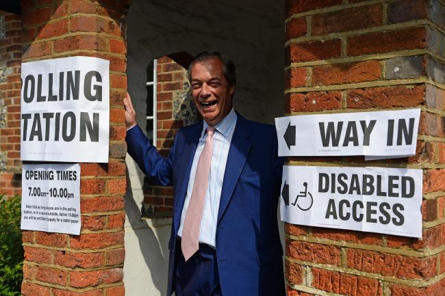Brexit Party leader Nigel Farage arrives to cast his vote for the European Parliament elections at a polling station in Biggin Hill, Kent