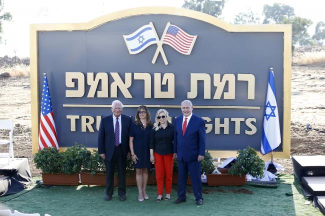 Israeli prime minister Benjamin Netanyahu, right, his wife Sara, centre right, United States Ambassador to Israel David Friedman, left, and his wife Tammy pose during the inauguration of the new settlement
